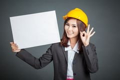 Asian engineer girl ok with a blank sign Royalty Free Stock Image