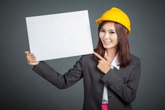 Asian engineer girl point to a blank sign Stock Photography