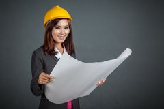 Asian engineer girl smile hold a blueprint Royalty Free Stock Images