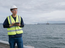 Asian engineer holding a tablet and standing Stock Image