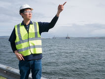 Asian engineer holding a tablet and standing Stock Images