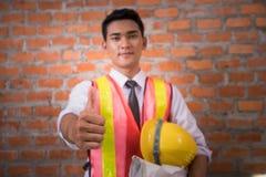 Asian engineer man with blueprints Royalty Free Stock Photos