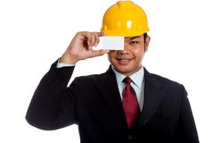 Asian engineer man close his eye with a blank card Royalty Free Stock Photography