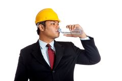 Asian engineer man drink water from a bottle Royalty Free Stock Images