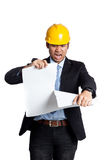 Asian engineer man frustrate tear a blueprint Royalty Free Stock Photography