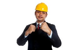 Asian engineer man with his fist rise ready to fig Royalty Free Stock Photography
