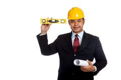 Asian engineer man  hold blue print and level look Royalty Free Stock Images