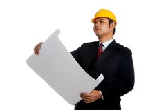 Asian engineer man hold a blue print looking up. Isolated on white background Stock Photography