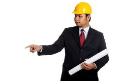 Asian engineer man hold blue print and point down. Isolated on white background Royalty Free Stock Photo