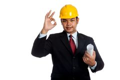 Asian engineer man hold blueprint and OK sign Royalty Free Stock Photos