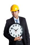 Asian engineer man hold a clock Stock Photography