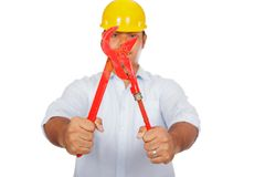 Asian engineer man hold red pipe wrench focus at t Royalty Free Stock Photo