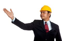 Asian engineer man open his hand present something Royalty Free Stock Photo