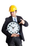 Asian engineer man point to a clock Stock Photos