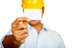 Asian engineer man show a blank card close his fac. E focus on the card isolated on white background stock photography