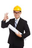 Asian engineer man show OK with blueprints Royalty Free Stock Photography