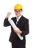 Asian engineer man success look at camera with blueprints Royalty Free Stock Images