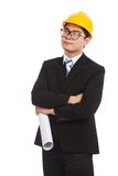 Asian engineer man think of something with blueprints Royalty Free Stock Images
