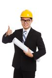 Asian engineer man thumbs up with blueprints Royalty Free Stock Photo