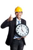 Asian engineer man thumbs up  with a clock Stock Images