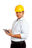 Asian engineer man use his tablet and smile look a Stock Photography