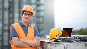 Asian engineer man using drone and laptop for construction site stock photo