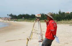 Asian engineer survey sea level Royalty Free Stock Photo