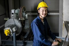 Asian engineer using notebook in factory stock photo