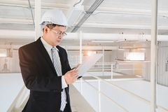 Asian engineer using tablet in industrial factory stock photos