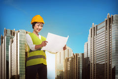 Asian engineer wearing safety vest Royalty Free Stock Images