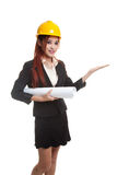 Asian engineer woman with blueprints show her palm hand. Royalty Free Stock Images