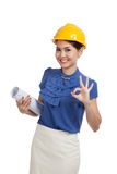Asian engineer woman with blueprints show OK hand sign Royalty Free Stock Photo