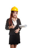 Asian engineer woman with blueprints show thumbs up. Stock Images