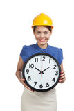 Asian engineer woman with a clock Stock Image