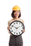 Asian engineer woman with a clock Stock Images