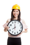 Asian engineer woman with a clock. Stock Images