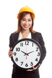 Asian engineer woman with a clock Royalty Free Stock Image