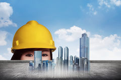 Asian engineer woman peeking from virtual plans of construction Stock Image