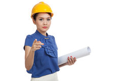Asian engineer woman pointing with blueprints Royalty Free Stock Images