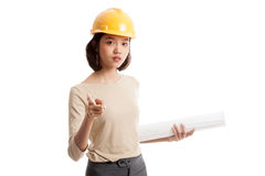 Asian engineer woman pointing with blueprints Royalty Free Stock Image