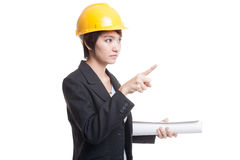 Asian engineer woman pointing with blueprints. Stock Photo