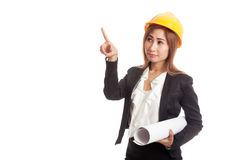 Asian engineer woman pointing with blueprints Royalty Free Stock Photo