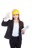 Asian engineer woman show OK with blueprints Stock Photo