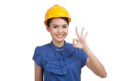 Asian engineer woman show OK sign Stock Photo