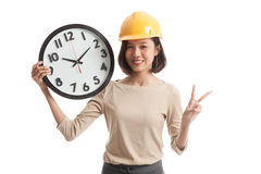 Asian engineer woman show victory sign with a clock Stock Photography