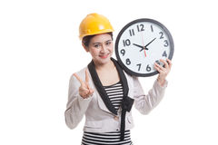 Asian engineer woman show victory sign with a clock. Stock Photography