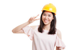 Asian engineer woman show Victory sign. Royalty Free Stock Photos