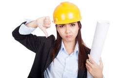 Asian engineer woman thumbs down with blueprints Stock Photos