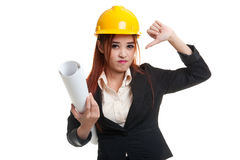 Asian engineer woman thumbs down with blueprints. Royalty Free Stock Photos