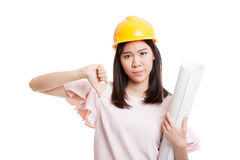 Asian engineer woman thumbs down with blueprints. Royalty Free Stock Image